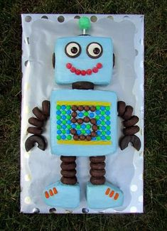 No tutorial, but easy to see the different mini donuts & candies… Robot Cake. No tutorial, but easy to see the different mini donuts & candies used for the details, etc. Robot Cupcakes, Robot Cake, Cupcake Cakes, Mini Donuts, Birthday Fun, Birthday Parties, Cake Birthday, Birthday Ideas, 5th Birthday Cakes For Boys
