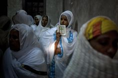 Ethiopian Orthodox Christian woman prays in the Church of the Holy Sepulchre in Jerusalem during their Easter celebrations - 2013 Pictures Of The Week, Cool Pictures, Old City Jerusalem, Human Fossils, Early Humans, Russian Icons, African Nations, Cultural Identity, Orthodox Christianity