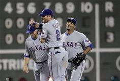 Texas Rangers center fielder Craig Gentry (23) celebrates with teammates Brandon Snyder, left, and Nelson Cruz, right, after the Rangers defeated the Boston Red Sox 18-3 in a baseball game at Fenway Park in Boston, Tuesday, April 17, 2012. (AP Photo/Elise Amendola) game 11