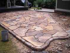 stacked stone garden edging | Brown Flagstone Garden Patio with moss rock border- Under Construction