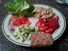 Honey mustard chicken with fixins, wrapped up in lettuce leaves with wasa cracker and strawberries