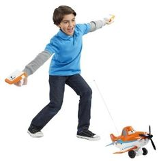 """Disney Planes Wing Control Dusty Crophopper Radio Control Plane.  Disney Planes Wing Control Dusty Crophopper Radio Control Plane: The amazing RC plane that lets you become the heroic """"flyer"""" from Disney Planes! The controller makes Wing Control Dusty Crophopper follow your every move, and his propellers start spinning when you drive him forward. He even has 3 pre-programmed moves he'll perform at the touch of a button! Includes Dusty Crophopper RC vehicle, left wing and right wing…"""