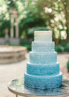 Blue ruffled ombre wedding cake