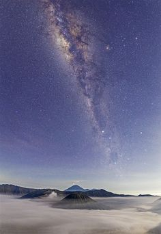 "Mount Bromo Volcano in Indonesia and The Milky Way Alexandru: ""After sunset, we trekked down to the village (Cemoro Lawang), stopping for a few moments to take this image. Mount Bromo and Semeru are seen at the bottom of the image, with The Milky Way arching above them."""