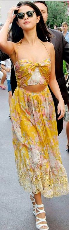 Yellow floral bow top, rose print lace skirt, and black sunglasses