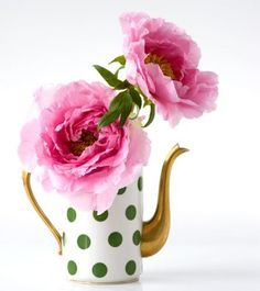 This just looks like a Kate Spade inspired centerpiece—Pink blossoms in Green and White Polka Dot Teapot with Gold Spout and Handle