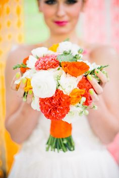 i love the bright pops of color in the bouquet; however would change the orange to a different color...