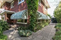 Jaren30woningen.nl | Groen witte #markiezen aan een #jaren30 woning