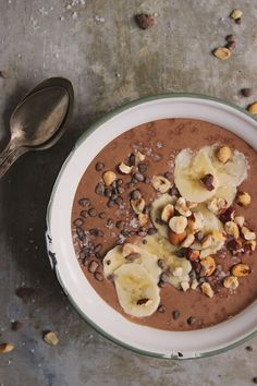 Chocolate Hazelnut Smoothie Bowl | @withfoodandlove * vegan, GF 2 tablespoons of chocolate protein powder 1 tablespoon raw cacao ½ cup toasted hazelnuts {see below} 2 bananas, peeled 1 cup unsweetened almond milk ¼ teaspoon sea salt Instructions Combine all of the ingredients in a blender, and blend until smooth. Pour the smoothie mixture into two bowls and top with garnishes below. Notes Topping options: sliced bananas crushed hazelnuts sea salt cacao nibs hemp seeds