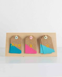 This DIY perpetual desk calendar can be used year after after, and the numbers -- stenciled onto inexpensive gift tags -- are easy to flip and rotate.