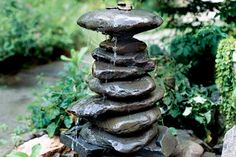 How To Build a River Rock Fountain - You can use just about any outdoor garden structure for a fountain, but you can't beat the organic beauty and simplicity of smooth, serene river rocks. This looks very DIY-able.