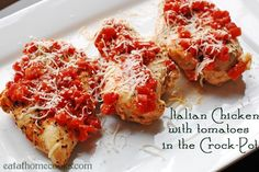 Italian Chicken with Tomatoes in the Crock-Pot.  Ingredients:  boneless chicken, red wine vinegar, basil, salt & pepper, Italian blend cheese, olive oil, oregano, garlic, and diced tomatoes.