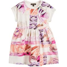 Girls pretty printed, soft cotton jersey dress by Roberto Cavalli. It features the designers rose print, in shades of pink and purple, with a metallic 'RC' logo on the bodice. It has capped sleeves and gathering around the waist providing a slight flare to the hem. A comfortable casual dress which simply pulls on over the head.<br /> <ul> <li>94% cotton, 6% elastane (soft jersey feel)</li> <li>Machine wash (30*C)</li> <li>True to size fitting</li> <li>Above the knee length</li> <li>Pul...