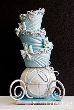 """Such a beautiful cake! """"Topsy Turvey Cinderella Carriage disney Wedding Cake - Cinderella Wedding Cake…I bet it disappeared after midnight! Made by 'Gimme Some Sugar' of Las Vegas. Check em out if you're looking for a custom wedding cake! Gorgeous Cakes, Pretty Cakes, Cute Cakes, Amazing Cakes, Disney Themed Cakes, Disney Cakes, Crazy Cakes, Fancy Cakes, Cinderella Wedding"""