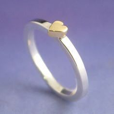 18k yellow gold heart atop a sterling silver ring by chris parry (via oh, hello friend)