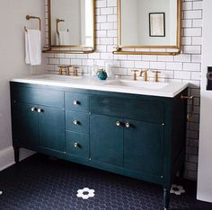 Fantastic bathroom with subway tiled wall with dark grout framing gold framed mirror flanked by sconces over white w=vanity accented with brass pulls alongside kilim rug layered over herringbone wood floors next to black clawfoot bathtub. Bathroom Renos, Small Bathroom, Washroom, Brass Bathroom, Blue Bathrooms, Navy Bathroom, Vanity Bathroom, Bathroom Goals, Bathroom Colors