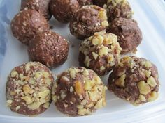 """Naughty But So Nice"" Double Chocolate Cherry Protein Balls 2 cups of rolled oats 1/3 cup of ground flax seeds 1/3 cup of sesame seeds 1 cup of white chocolate chips 1 cup dried cherries 1/2 cup cocoa 1 cup walnuts 2 cups of Almond Butter (use whatever nut butter you like) 1/2 cup honey (a little more if the balls aren't sticking together properly)"
