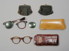 Lot 279: Two pairs of glasses (major losses and corrosion to one pair) including one prescription, the other sunglasses (partial) together with two black satin coin purses. Also present is a Christie's tag as these items were originally intended to be sold there in 1999. From the personal property of Marilyn Monroe.