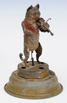 "Clockwork toy of ""cat playing violin "", late 19th century."