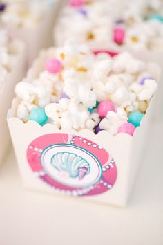 Popcorn and pearled colored sixlets. cute snack! pearl_princess_party