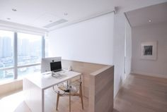 Boathouse Home Office is a minimalist house located in Hong Kong, designed by Bean Buro. The three bedroom apartment in Aberdeen Larvotto was refurbished and transformed into to a live/work/play apartment for a French couple with three cats. (6)