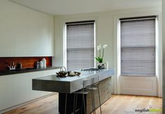 Rustic grey wooden blinds in a contemporary kitchen.