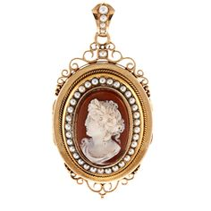 This gorgeous locket pendant features a detailed cameo design in pristine condition. This estate jewelry is adorned with round-shaped white freshwater pearls for a shimmering, elegant look.