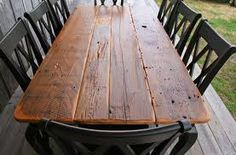 I love the old beat up wood tables! I used to have one like this, it was great, need again... With picnic benches...yep.