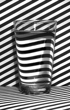 Asymmetry: This picture shows Asymmetry in the way the lines in the back of the cup all go one certain way. But inside the glass there's a similar pattern but not quite the same. This picture also shows Unclutter and color black and white.