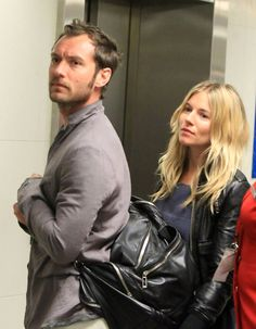 Jude Law and Sienna Miller at Heathrow Airport.  (2011)