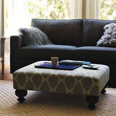 I love this style ottoman. Perfect for putting feet up but good for drinks/etc. with a tray on top