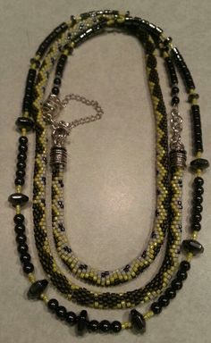 Sue Jacobson's 6 around bead crochet serpent necklace made with delica beads size 11, larger hematitebeads and Sterling Silver findings.  It is convertible from a three strand choker to a longer two strand necklace.