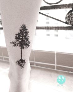pine tree with heart roots tattoo