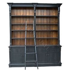 Two Toned Bookcase -- This is what I'd love to do in my new office. Black to match my custom desk and the lighter wood undertone to match my flooring.
