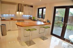 White kitchen with wooden work surface