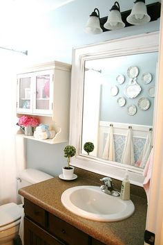 Hang towels from wood trim above beadboard wallpaper on lower section of 1/2 bath.