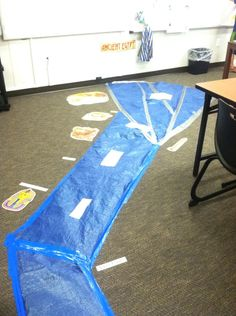 The Nile Delta....Nile River using blue tarp in my classroom. Added facts along the river, city names, and bulletin board cutouts.