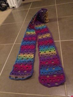 Crochet skull scarf in a variegated rainbow yarn. This pattern is very easy to follow. It's not free but a very reasonable price!