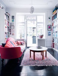 A Danish home. More colourful than the usual Scandinavian style. Book shelves around the whole room with the red sofa as a focal point Living Room Red, Home And Living, Living Spaces, Small Living, The Block Room Reveals, Deco Studio, Sofa Colors, Interior Exterior, Dream Decor