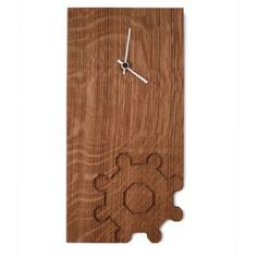 Wall clock Mina. Made of oak. Available in four variants: Trullo, Castel del Monte, Apulia and Olive. Designer: Alessandro Giuseppe