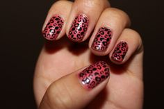 Leopard print nails.    Konad Image Plate M57  Sally Hansen New Lengths Ceramics - Coral Pink  Seche Vite Top Coat    This design turned out so well! I had to cut my nails a little shorter to cover my entire nail properly. If there was any leopard spots left on my stamper I would stamp it onto any blank spots on my nails. :)
