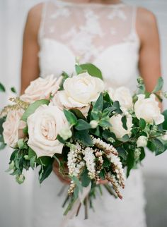 Rose, clematis and greenery wedding bouquet: http://www.stylemepretty.com/2016/11/14/formal-southern-elegance-blush-velvet-and-claret-inspiration/ Photography: Studio Elle - http://studioellephoto.com/