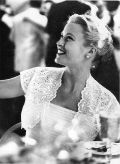 Grace Kelly at a wedding or dinner party wearing pearl stud earrings