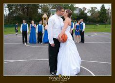 bride on basketball court | Basketball Bride Vermont Wedding Photographer