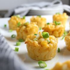 Mac N Cheese Bites - the ultimate comfort food!  A decadent combination of Gruyere & Cheddar cheese… little gifts of goodness in every bite!