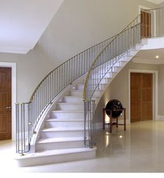 Steel-supported honed Moleanos staircase with polished Moleanos stone flooring – Hertfordshire Stair Railing Design, Staircase Railings, Curved Staircase, Staircases, Classic House Design, Simple House Design, Modern House Design, Limestone House, Georgian Buildings