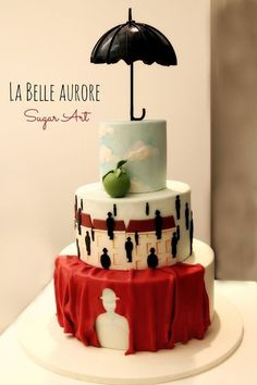 Magritte art cake... this is a freaking amazing cake. I love these paintings. So neat to see it interpreted in cake form!