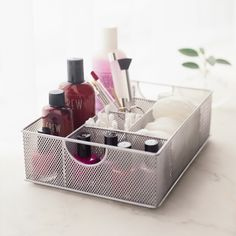 Keep your make up and accessories tidy and organised in this silver wire mesh vanity organiser. Divided into compartments you can keep your nail polishes, make up brushes and other accessories separate and within easy reach - essential when you're getting ready in a hurry in the morning!