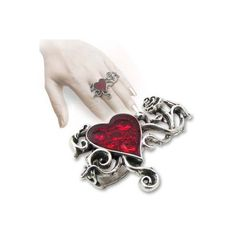 Ring Bed Of Blood Roses ($48) ❤ liked on Polyvore featuring jewelry, rings, heart shaped rings, sparkle jewelry, heart-shaped jewelry, rose ring and heart ring