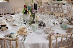 Table laid for vintage afternoon tea wedding party by www.chippingnortonteaset.co.uk